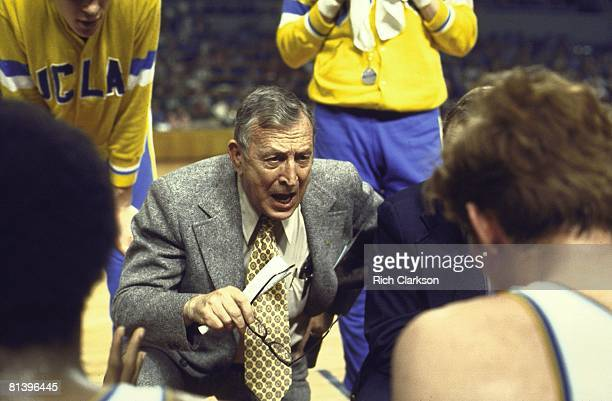 College Basketball NCAA playoffs UCLA coach John Wooden in huddle with team during timeout Los Angeles CA 3/23/1972