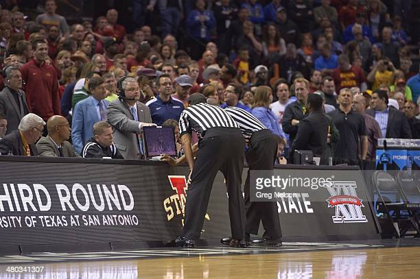 NCAA Playoffs View of referees watching video replay at scorer's table during Iowa State vs UNC game at ATT Center San Antonio TX CREDIT Greg Nelson