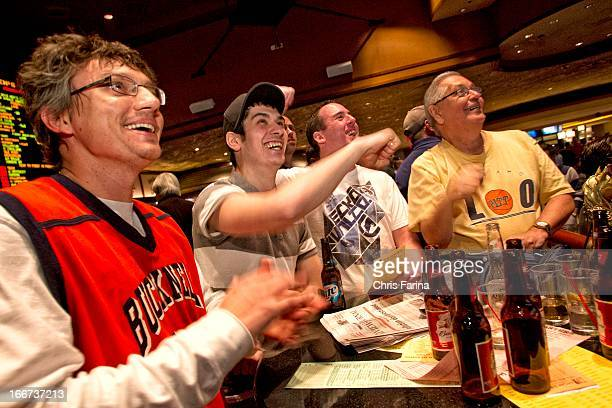 NCAA Playoffs View of sports book patrons betting on March Madness games at Mirage Hotel Casino Las Vegas NV CREDIT Chris Farina