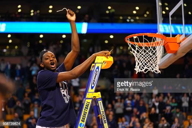 NCAA Playoffs Villanova Dhamir CosbyRoundtree victorious on ladder after cutting net after winning game vs Texas Tech at TD Garden Boston MA CREDIT...
