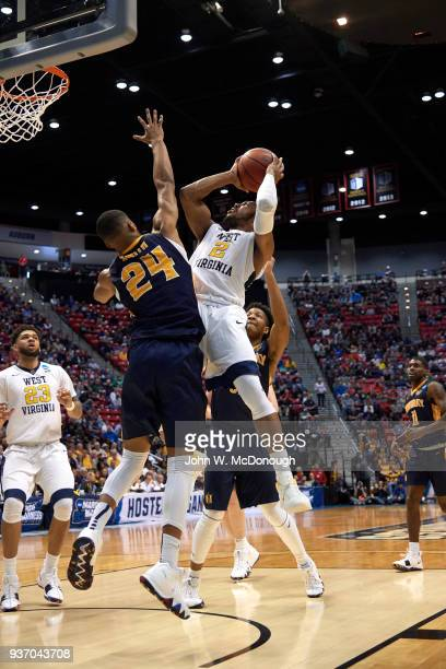 West Virginia Jevon Carter in action layup vs Murray State Anthony Smith at Viejas Arena San Diego CA CREDIT John W McDonough