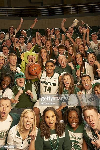 Tournament Preview: Portrait of Michigan State guard Gary Harris during photo shoot with student section at Breslin Center. East Lansing, MI...
