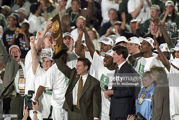 Final Four: Michigan State coach Tom Izzo victorious with team and NCAA National Championship trophy after winning game vs Florida. Indianapolis, IN...