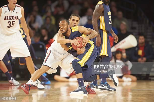 NIT Season TipOff Arizona Nick Johnson in action defense vs Drexel Chris Fouch at Madison Square Garden New York NY CREDIT Porter Binks
