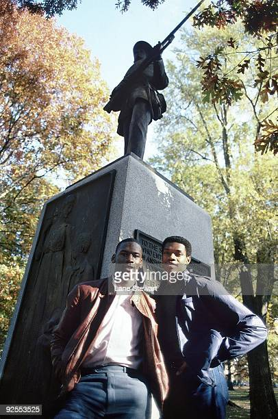 North Carolina Michael Jordan and Sam Perkins posing by Silent Sam statue on UNC campus Chapel Hill NC CREDIT Lane Stewart