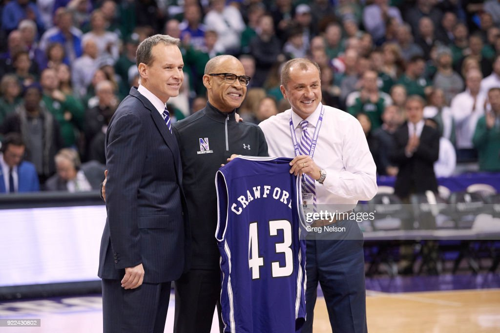 Northwestern coach Chris Collins (L) presenting jersey to former NBA referee Danny Crawford with Director of Athletics Dr. Jim Phillips before game vs Michigan State at Allstate Arena. The number 43 is for the number Crawford wore as a referee. Greg Nelson TK1 )