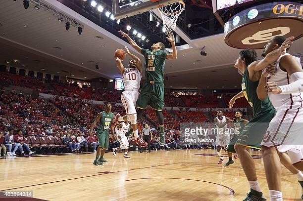 Oklahoma Jordan Woodard in action vs George Mason Trey Porter at Lloyd Noble Center. Norman, OK CREDIT: Greg Nelson