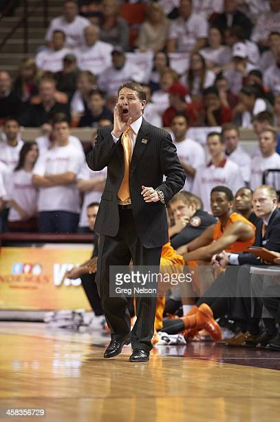 Oklahoma State coach Travis Ford on sidelines during game vs Oklahoma at Lloyd Noble Center Norman OK CREDIT Greg Nelson