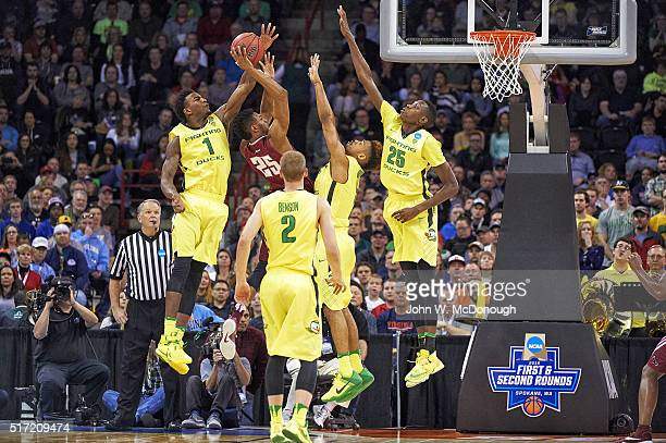 Oregon Jordan Bell Tyler Dorsey and Chris Boucher in action defense vs St Joseph's James Demery at Spokane Veterans Memorial Arena Spokane WA CREDIT...