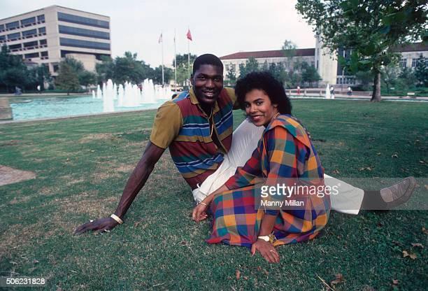 Portrait of Houston center Akeem Olajuwon posing with his girlfriend Lita Spencer during photo shoot on UH campus Houston TX CREDIT Manny Millan