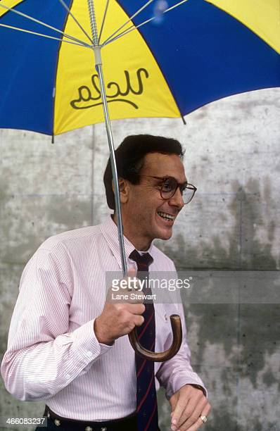 Portrait of Kansas coach Larry Brown holding up UCLA umbrella Lawrence KS CREDIT Lane Stewart