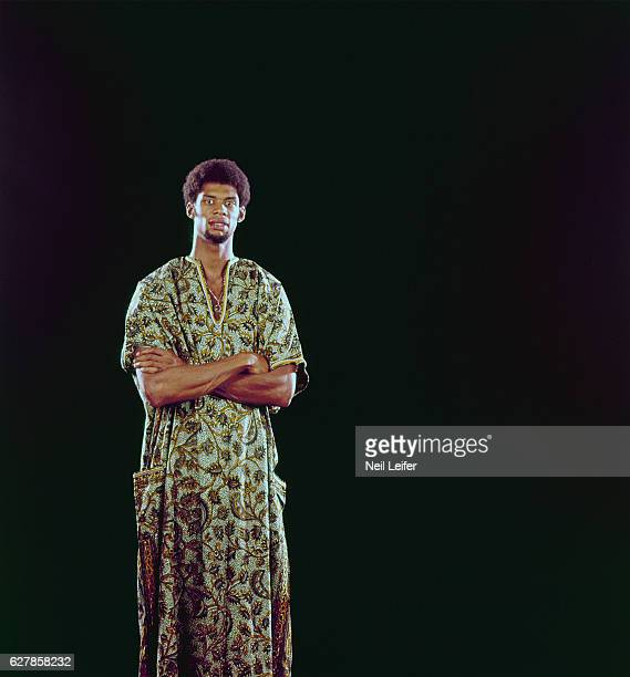 Portrait of Milwaukee Bucks Lew Alcindor wearing African dashiki during photo shoot in studio New York NY CREDIT Neil Leifer
