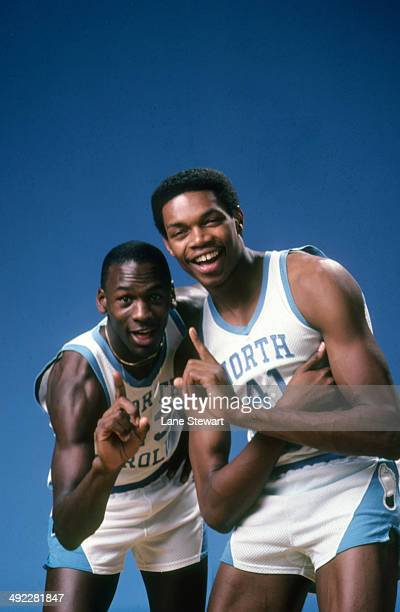 Portrait of North Carolina Michael Jordan and Sam Perkins gesturing number 1 on University of North Carolina campus Chapel Hill NC CREDIT Lane Stewart
