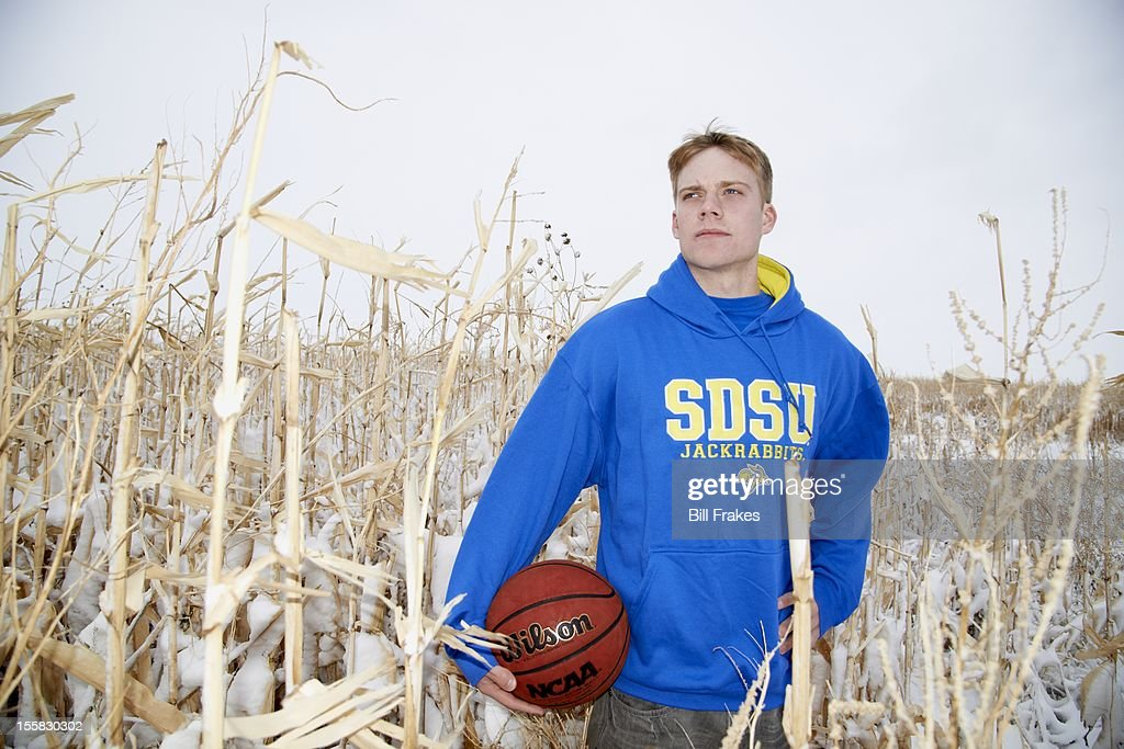 Portrait of South Dakota State point guard Nate Wolters casual during photo shoot in a snowy cornfield. Bill Frakes F36 )