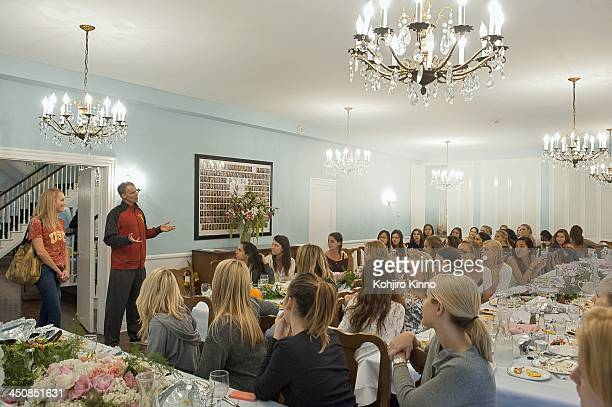 Portrait of USC head coach Andy Enfield speaks to Greek sorority Pi Phi as his wife Amanda Marcum watches on The Row at West 28th Street Los Angeles...