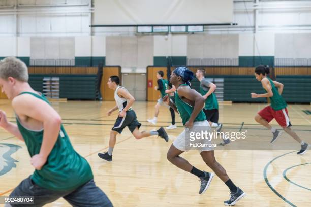 college basketball practice - sports training drill stock pictures, royalty-free photos & images