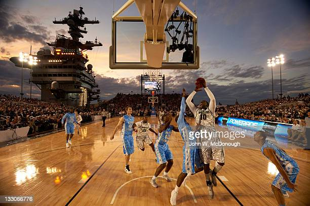 Quicken Loans Carrier Classic Michigan State Draymond Green in action shot vs North Carolina Leslie McDonald during game aboard USS Carl Vinson...
