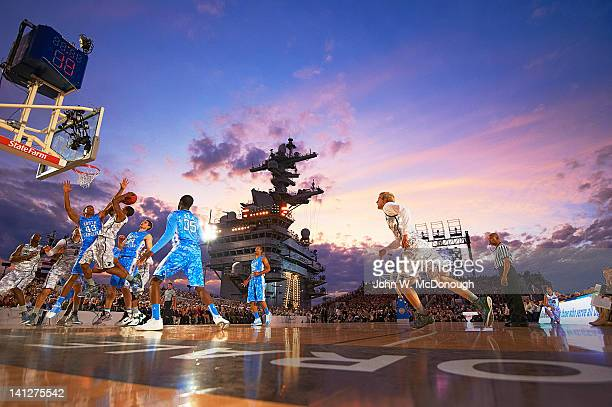 Quicken Loans Carrier Classic North Carolina James Michael McAdoo in action defense vs Michigan State Keith Appling aboard USS Carl Vinson aircraft...