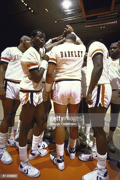 College Basketball Rear view of Auburn Charles Barkley on court in huddle with team before game vs Mississippi State Auburn AL 3/2/1984