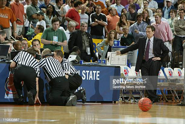 College Basketball referee official examining videotape of Patrick Sparks' gametying shot Michigan State head coach Tom Izzo against Kentucky during...