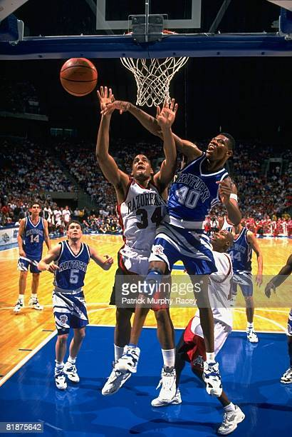 College Basketball SEC Tournament Kentucky Walter McCarty in action getting rebound vs Arkansas Corliss Williamson Fayetteville AR 3/8/1994