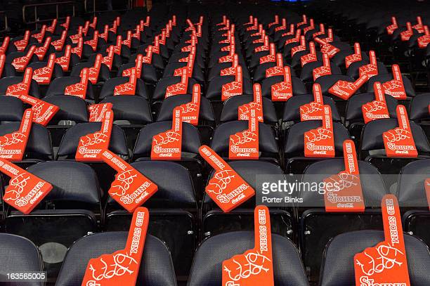 St John's number one foam fingers on courtside seats before game vs Marquette at Madison Square Garden New York NY CREDIT Porter Binks