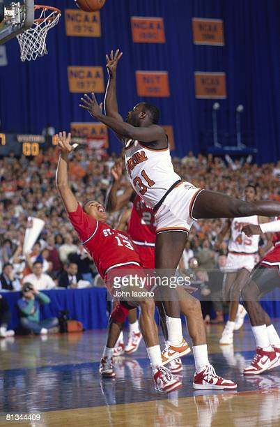 College Basketball Syracuse Dwayne Pearl Washington in action taking shot vs St John's Mark Jackson Syracuse NY 2/1/1986