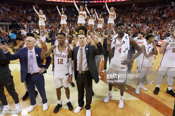 Texas assistant coach Denny Kuiper Kerwin Roach III assistant coach Darrin Horn and Mohamed Bamba signaling hook 'em horns with fingers after game vs...