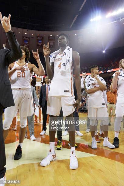 Texas Mohamed Bamba victorious signaling hook 'em horns with fingers after game vs Mississippi at Frank Erwin Center Austin TX CREDIT Greg Nelson