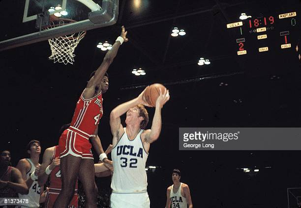 College Basketball UCLA Bill Walton in action taking layup vs Maryland Len Elmore Cover Los Angeles CA 12/1/1973