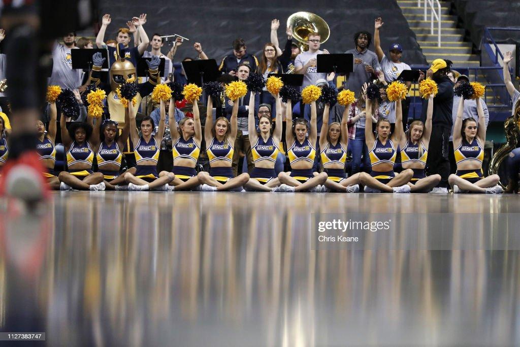 UNC Greensboro cheerleaders on court during game vs Virginia