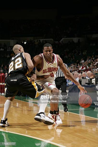 College Basketball University of WisconsinMIlwaukee Ed McCants against Alabama Earnest Shelton during the first round of the NCAA Tournament on March...