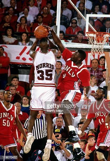 UNLV Larry Johnson in action defense vs Arkansas Isaiah Morris at Barnhill Arena Fayetteville AR CREDIT Manny Millan
