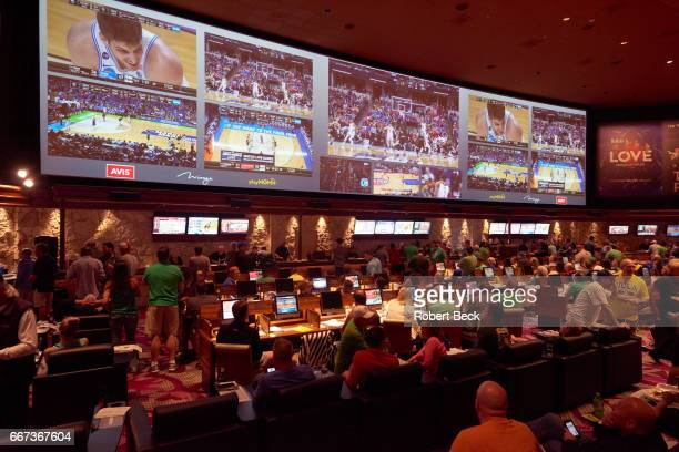 View of fans watching NCAA tournament games from sportsbook lounge in Mirage Hotel After years of professional sports leagues shying away from Las...