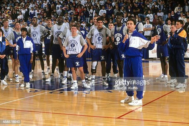 View of Kentucky players on court as head coach Rick Pitino addresses the crowd after Midnight Madness practice at Rupp Arena View of assistant coach...