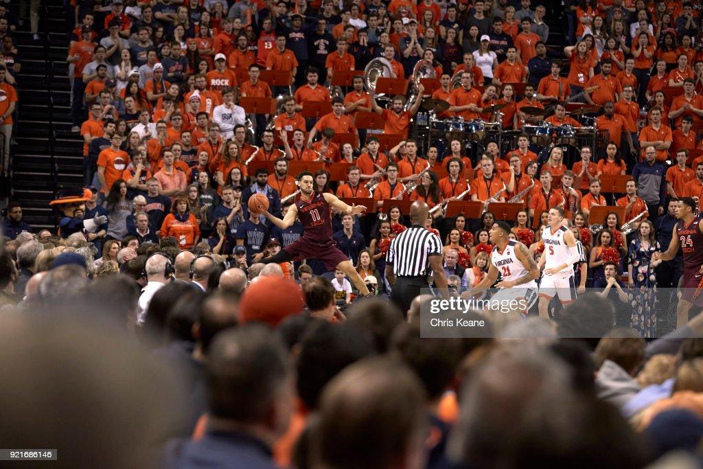 Virginia Tech Devin Wilson (11) in action, passing vs Virginia at John Paul Jones Arena. Chris Keane TK1 )
