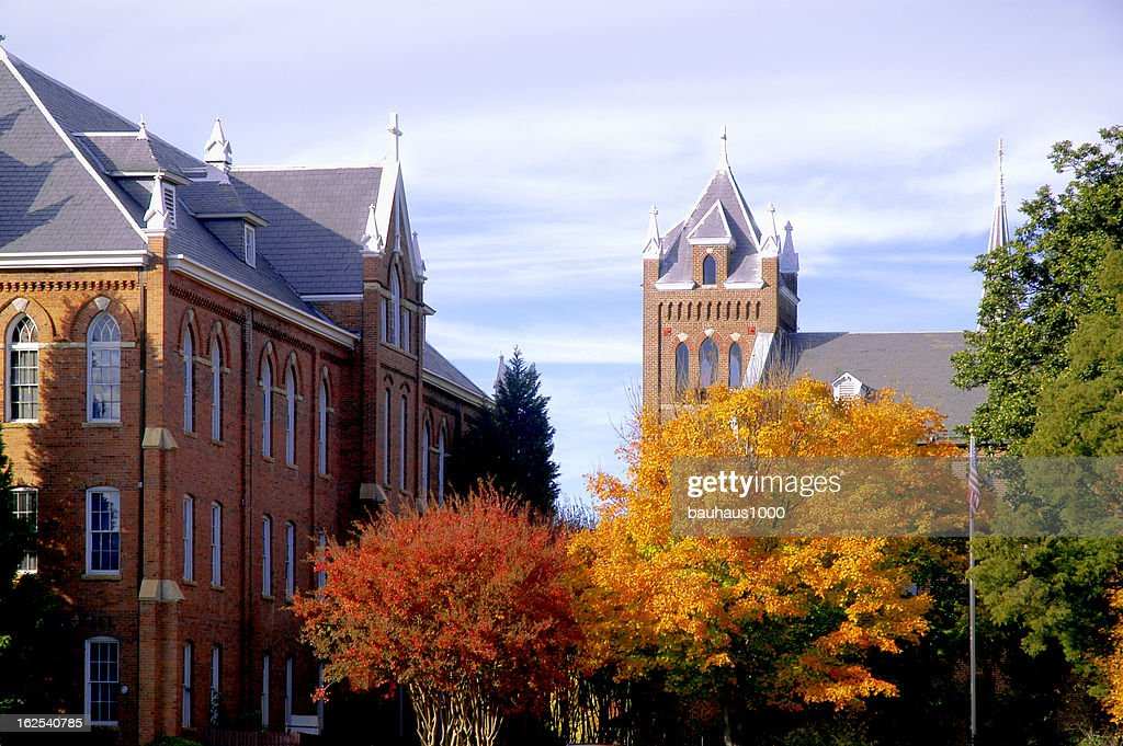 College campus during fall with changing trees : Stock Photo
