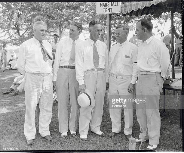 College Coaches at Golf Classic. Near Chicago, Illinois: Five prominent college coaches as they acted as scorers and marshals during the 1933...