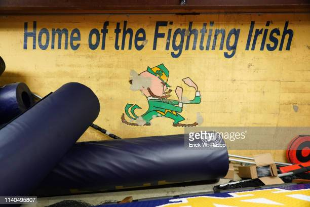 90th BlueGold Game Closeup of mural in Notre Dame locker room reading HOME OF THE FIGHTING IRISH above the Leprechaun mascot at Notre Dame Stadium...