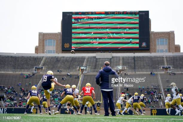 90th BlueGold Game Rear view of Notre Dame Jay Bramblett in action punting during spring exhibition game at Notre Dame Stadium South Bend IN CREDIT...