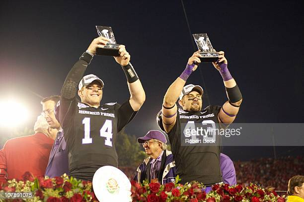 97th Rose Bowl Texas Christian QB Andy Dalton and Tank Carder victorious holding up offense and defense Player of the Game Trophy after winning game...