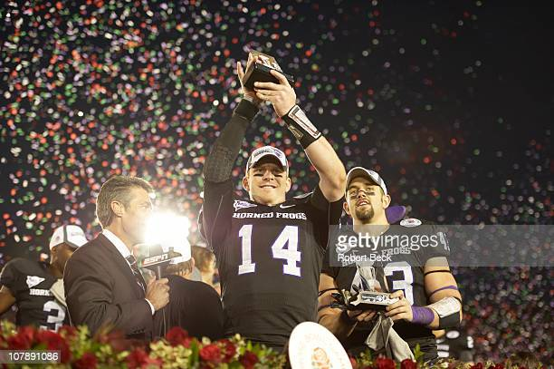 97th Rose Bowl Texas Christian QB Andy Dalton victorious holding up offense Player of the Game Trophy after winning game vs Wisconsin at Rose Bowl...