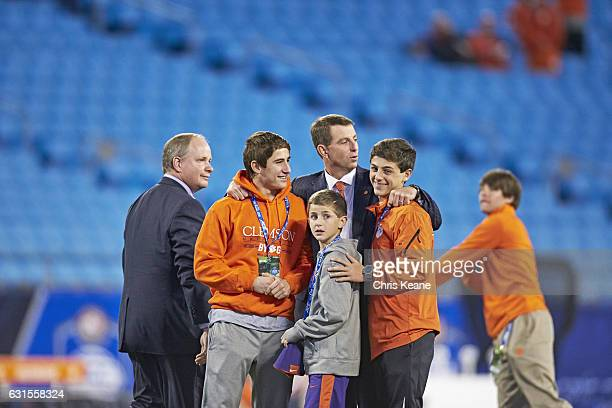 ACC Championship Clemson head coach Dabo Swinney on field with his sons Drew Will and Clay before game vs North Carolina at Bank of America Stadium...