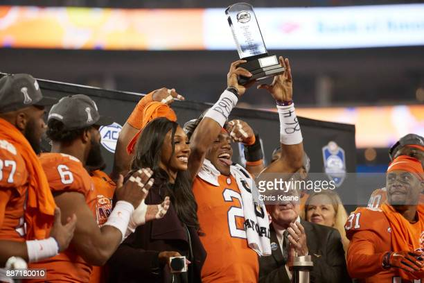ACC Championship Clemson QB Kelly Bryant victorious holding up MVP trophy after winning game vs Miami at Bank of America Stadium ESPN analyst Maria...