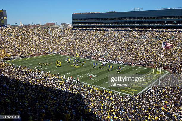 Aerial view of Michigan cheerleaders on field with flags spelling out MICHIGAN before game vs Penn State at Michigan Stadium Ann Arbor MI CREDIT Jeff...