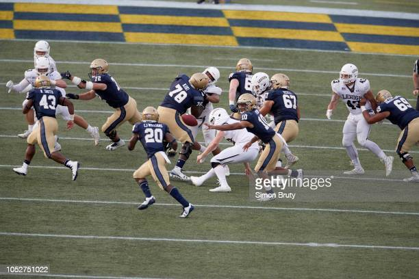 Aerial view of Navy QB Malcolm Perry in action shuffle pass option to CJ Williams vs Lehigh at NavyMarine Corps Memorial Stadium Annapolis MD CREDIT...