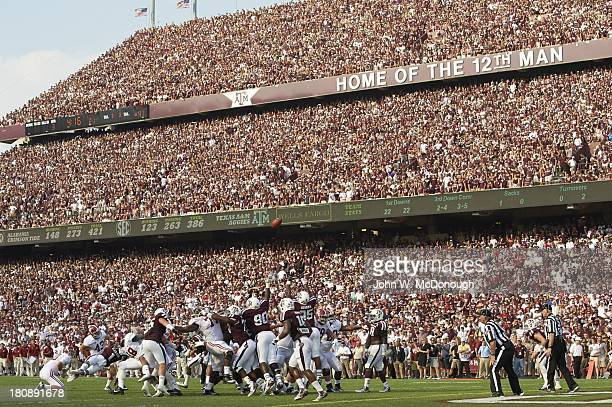 Alabama Cade Foster in action kicking extra point field goal vs Texas AM at Kyle Field Overall view of fans in stands banner sign reading HOME OF THE...