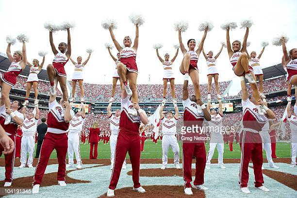 Alabama cheerleaders performing on field during game vs Penn State Tuscaloosa AL 9/11/2010 CREDIT Greg Nelson