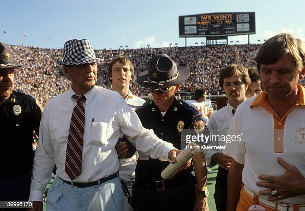 Alabama coach Bear Bryant with Tennesse coach Johnny Majors after game at BryantDenny Stadium Birmingham AL CREDIT Heinz Kluetmeier