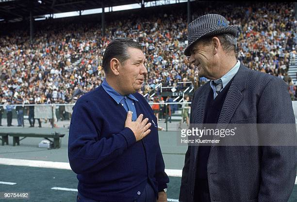 Auburn coach Shug Jordan and Alabama coach Paul Bear Bryant on field before game at Legion Field Birmingham AL CREDIT Heinz Kluetmeier